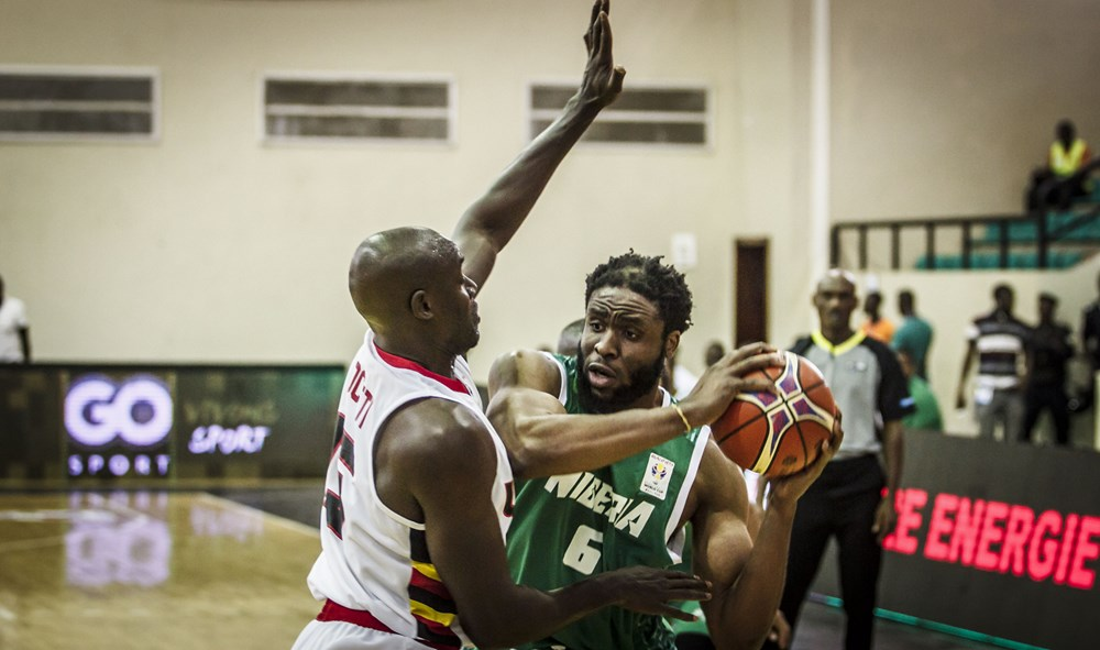 Stanley Ociti (left) trying to stop Nigeria's Ike Diogu(right) yesterday.