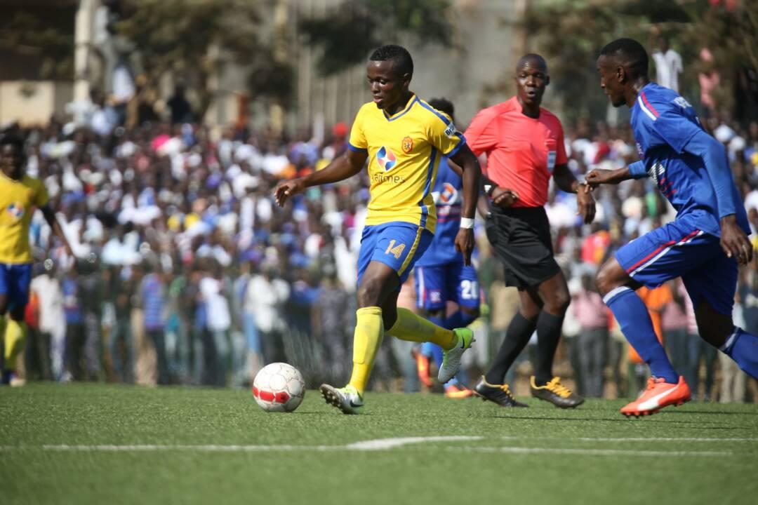 KCCA's Paul Mucureezi (left) in action against Villa on Thursday evening.