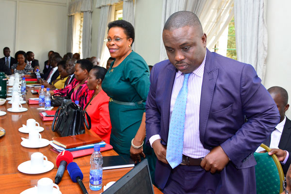 Lord Mayor Erias Lukwago with Kampala minister Bettie Olive Kamya at a Parliamentary Committee hearing last year: NET PHOTO