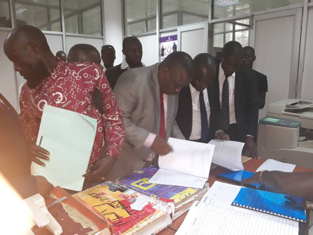 Lord Mayor Erias Lukwago (2nd left) peruses court documents at the High Court in Kampala today: PHOTO BY RACHEAL AGABA