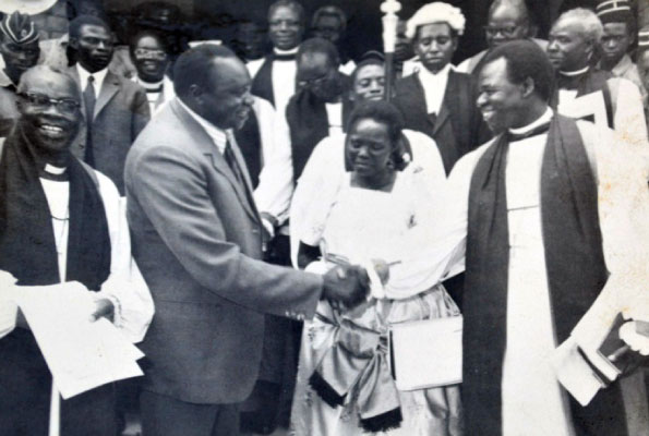Archbishop Janani Luwum greets then president Idi Amin after church service.