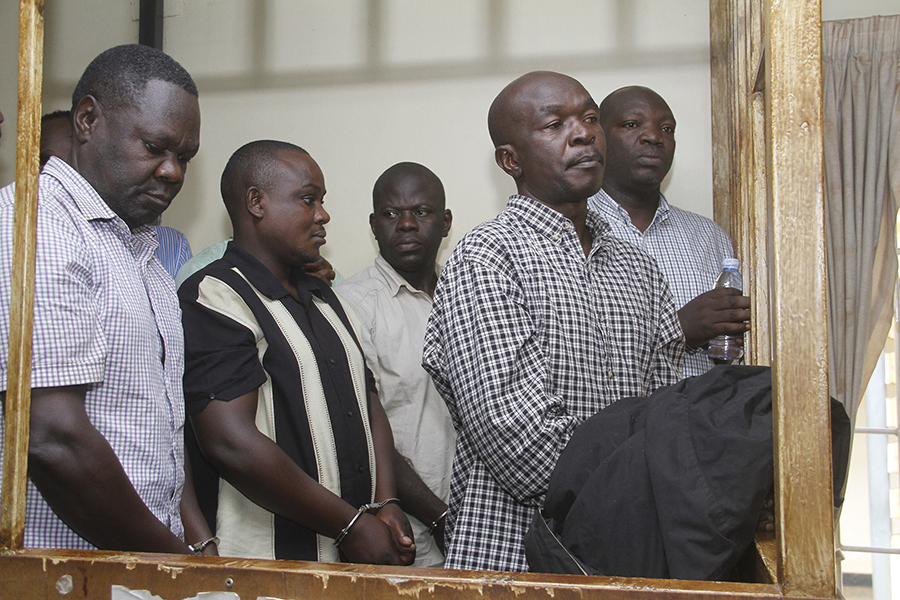 Nixon Agasirwe (Right) with other police officers in the dock at the General Court Martial in Makindye: NET PHOTO