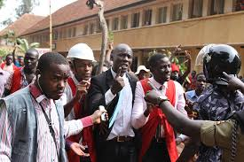 Police officers confront Makerere University students during a past strike. File photo.