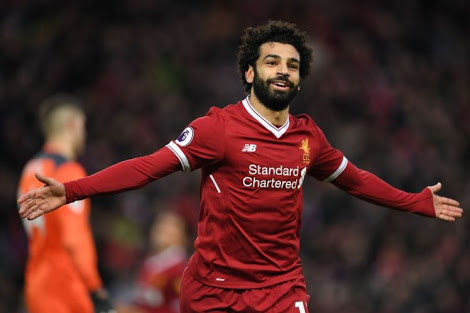 Liverpool's Egyptian midfielder Mohamed Salah celebrates scoring his team's second goal during the English Premier League football match between Liverpool and Southampton at Anfield in Liverpool, north west England on November 18, 2017. / AFP PHOTO / Paul ELLIS / RESTRICTED TO EDITORIAL USE. No use with unauthorized audio, video, data, fixture lists, club/league logos or 'live' services. Online in-match use limited to 75 images, no video emulation. No use in betting, games or single club/league/player publications.  /         (Photo credit should read PAUL ELLIS/AFP/Getty Images)