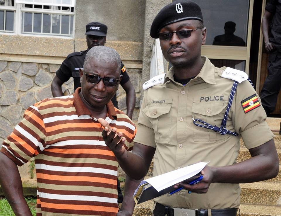 Kampala Metropolitan Police spokesperson Luke Owoyesigire with the suspect on Friday: COURTESY PHOTO