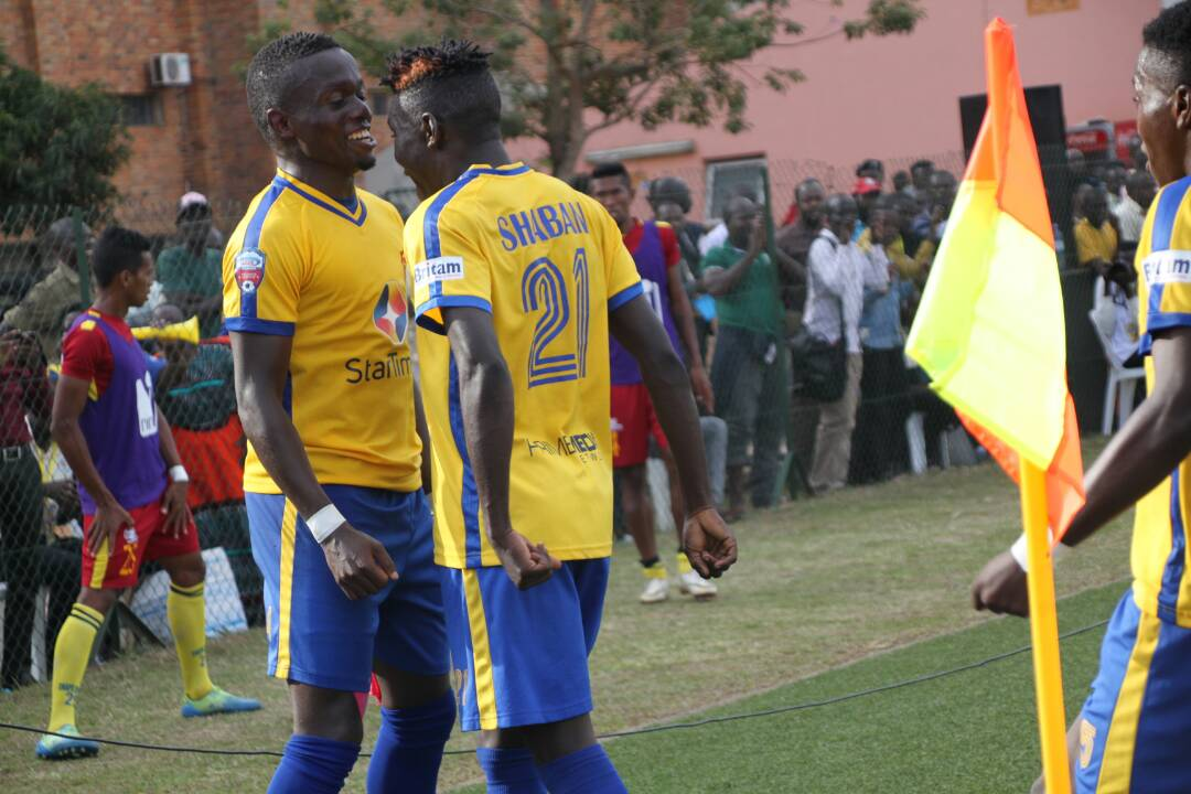 KCCA's Paul Mucurezi(left) celebrating his goal against CNaPS with Shaban Muhammed(right),in the preliminary round of the CAF Champions league. KCCA FC won the game 1-0 to progress to the first round.