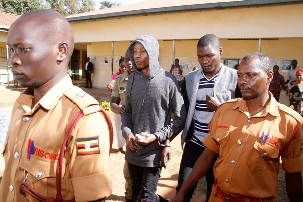 Brian White and co-accused Okot being escorted to court recently: NET PHOTO