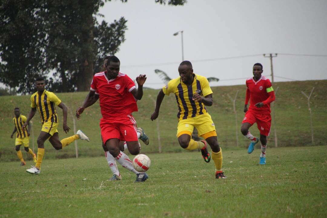 Express FC's Juma Ssebaduk (left) and Proline midfielder Sula Matovu (right) during the 0-0 draw at Wankulukuku: PHOTO BY SHABAN LUBEGA