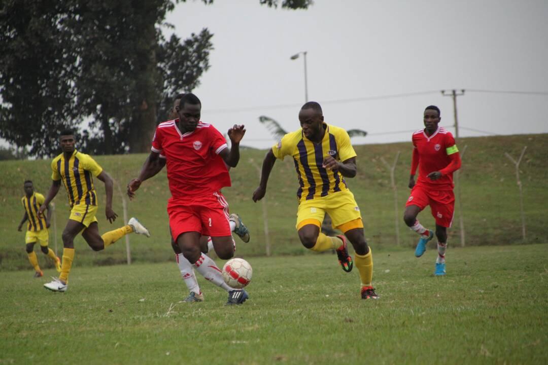 Express FC's Juma Ssebaduk (left) and Proline midfielder Sula Matovu (right) during the 0-0 draw at Wankulukuku: PHOTO BY SHABAN LUBEGA