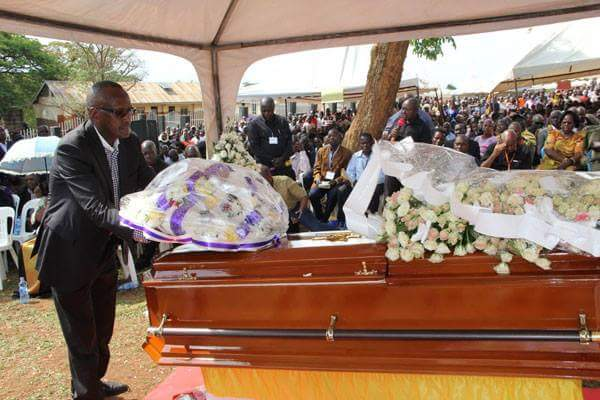 Gen Henry Tumukunde lays a wreath on Suzan Magara's casket at the burial in Hoima on Thursday.