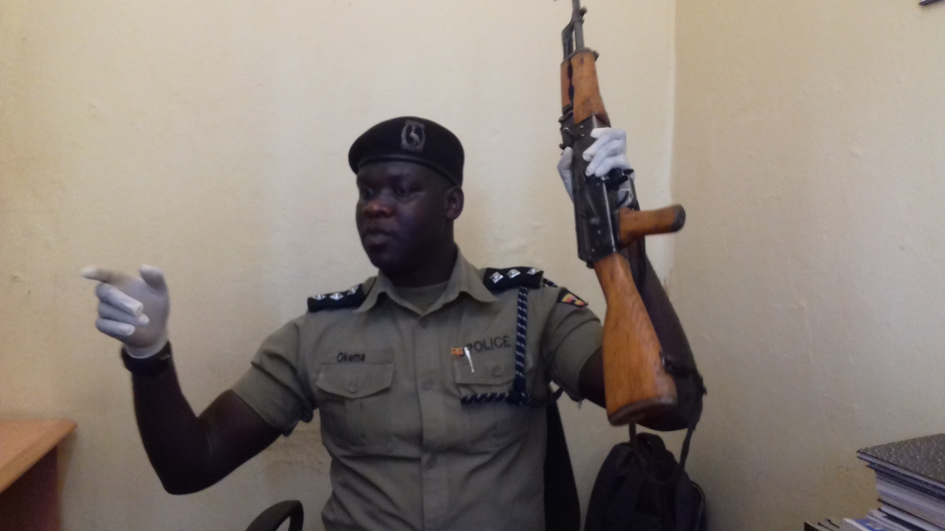 Poems shows the recovered gun to journalists in Gulu on Friday: PHOTO BY DAVID OKEMA