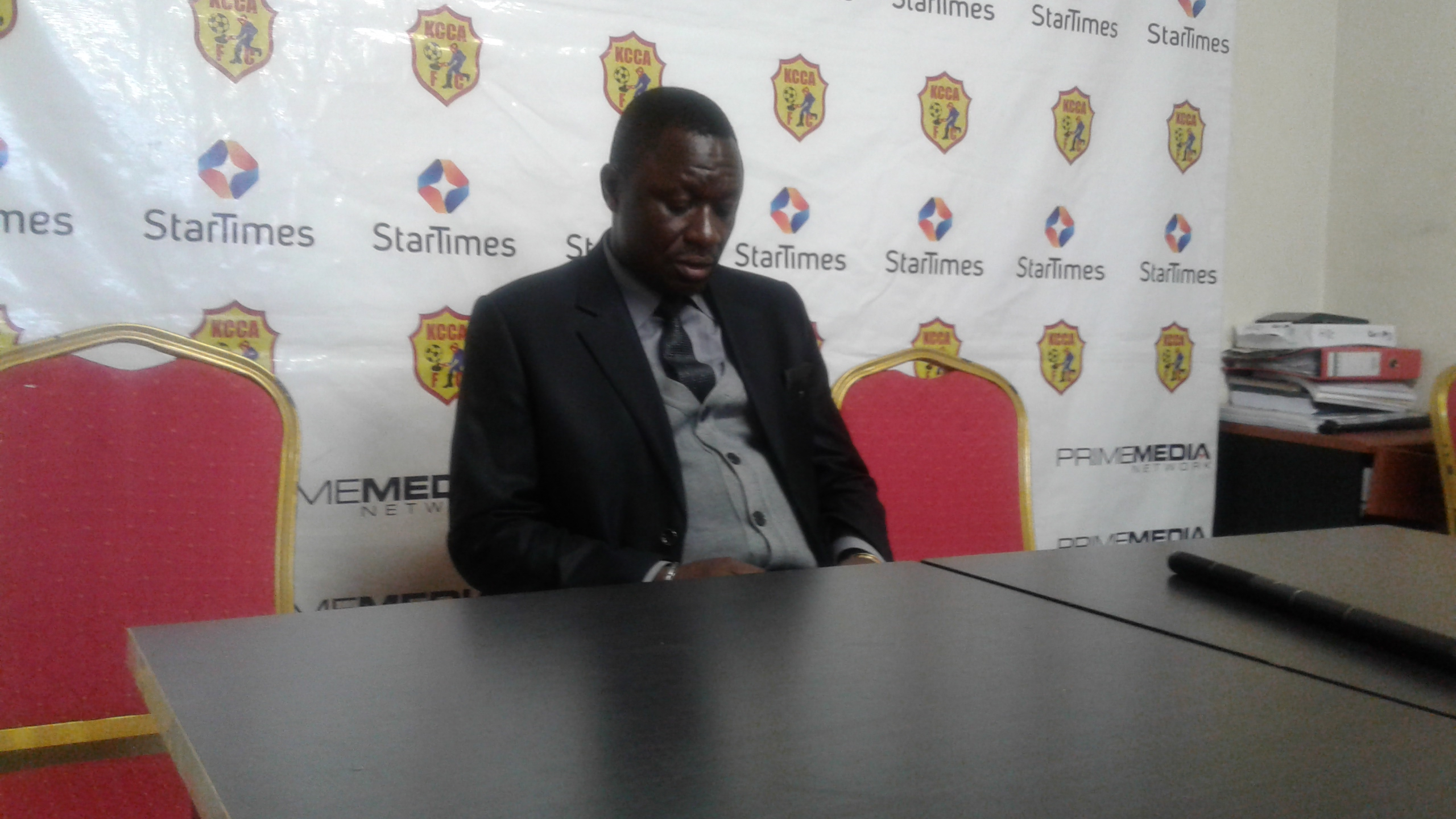 Mike Mutebi speaking to the media after the 7-2 win over URA (Photo by Shaban Lubega)