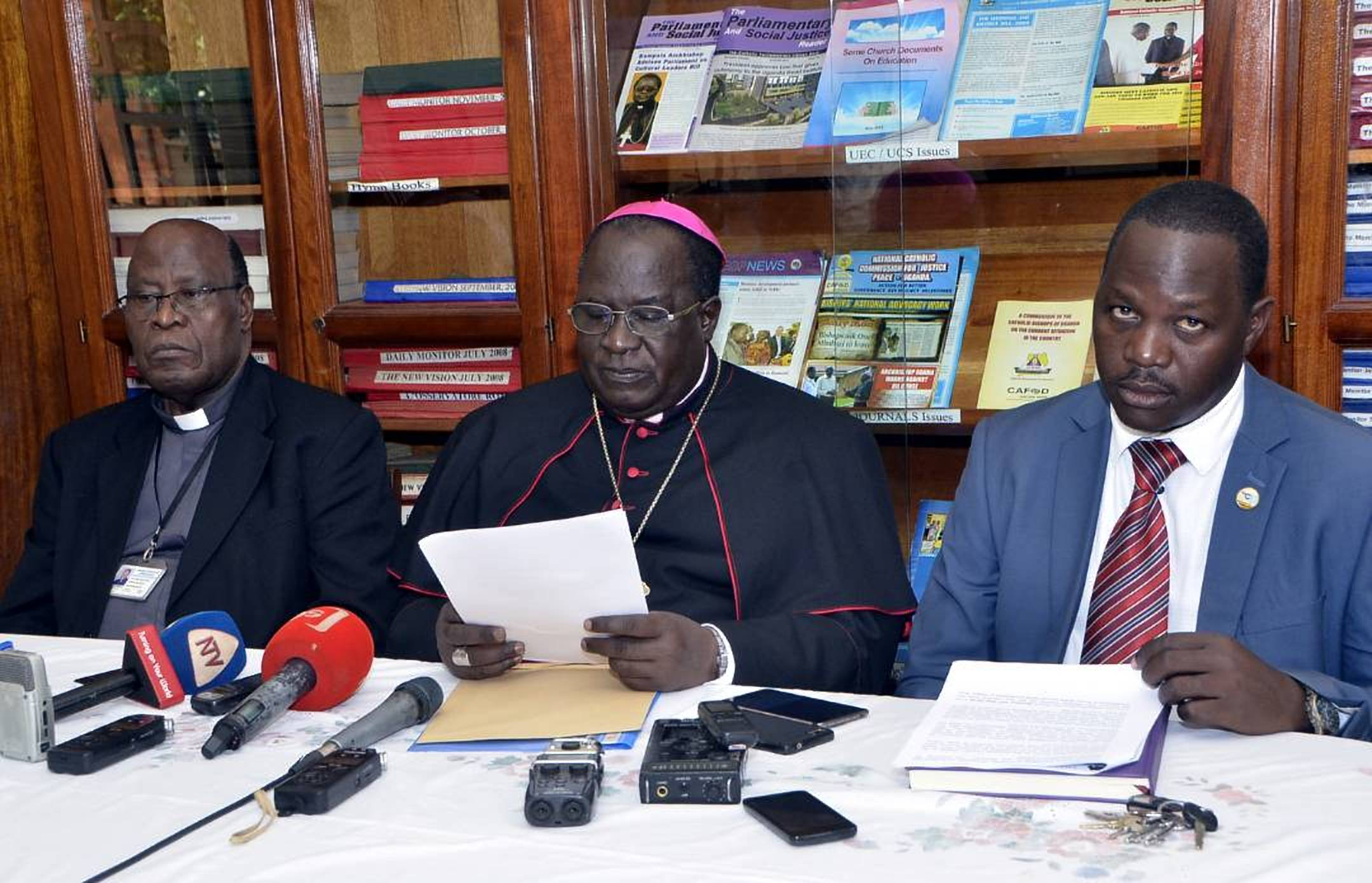 Msgr. J.B Kauta, Archbishop Obbo and Mr Robert Kamiza, the chairman of the Organising Committee addressing  the press (PML photo)