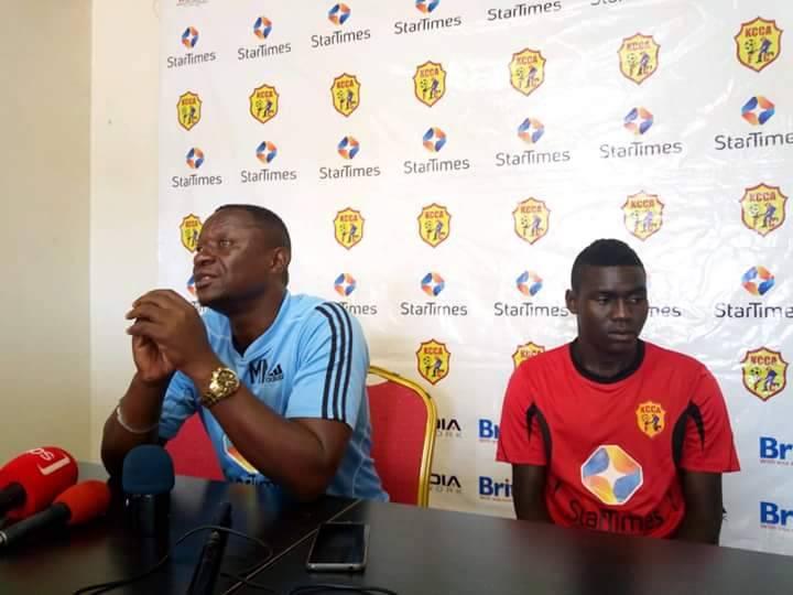 Mike Mutebi(left) addressing the media on Tuesday morning. Right is striker Shaban Muhammad.