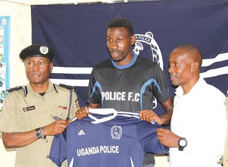 Abdallah Mubiru (right) during his unveiling at Police FC