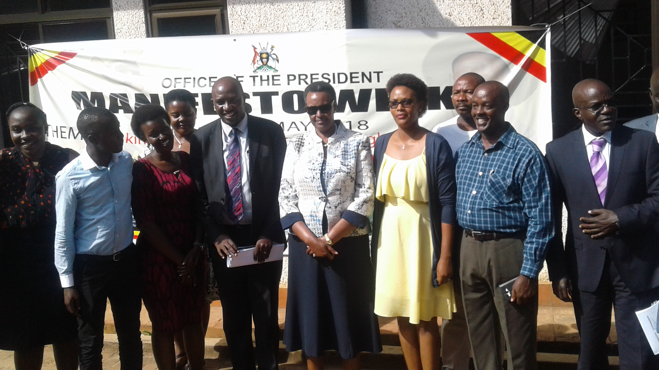 Education Minister Janet Museveni poses with officials at the Uganda Media Centre.  To her immediate right is NRM Manifesto Implementation Unit director Willis Bashasha.