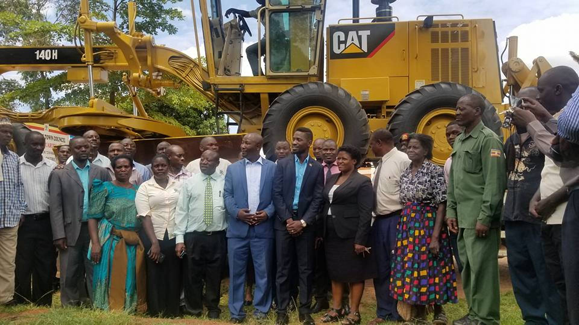 Kyadondo East MP Robert Kyagulanyi is joined by other leaders in a group photo following the unveiling of the heavy duty grader (COURTESY PHOTO)