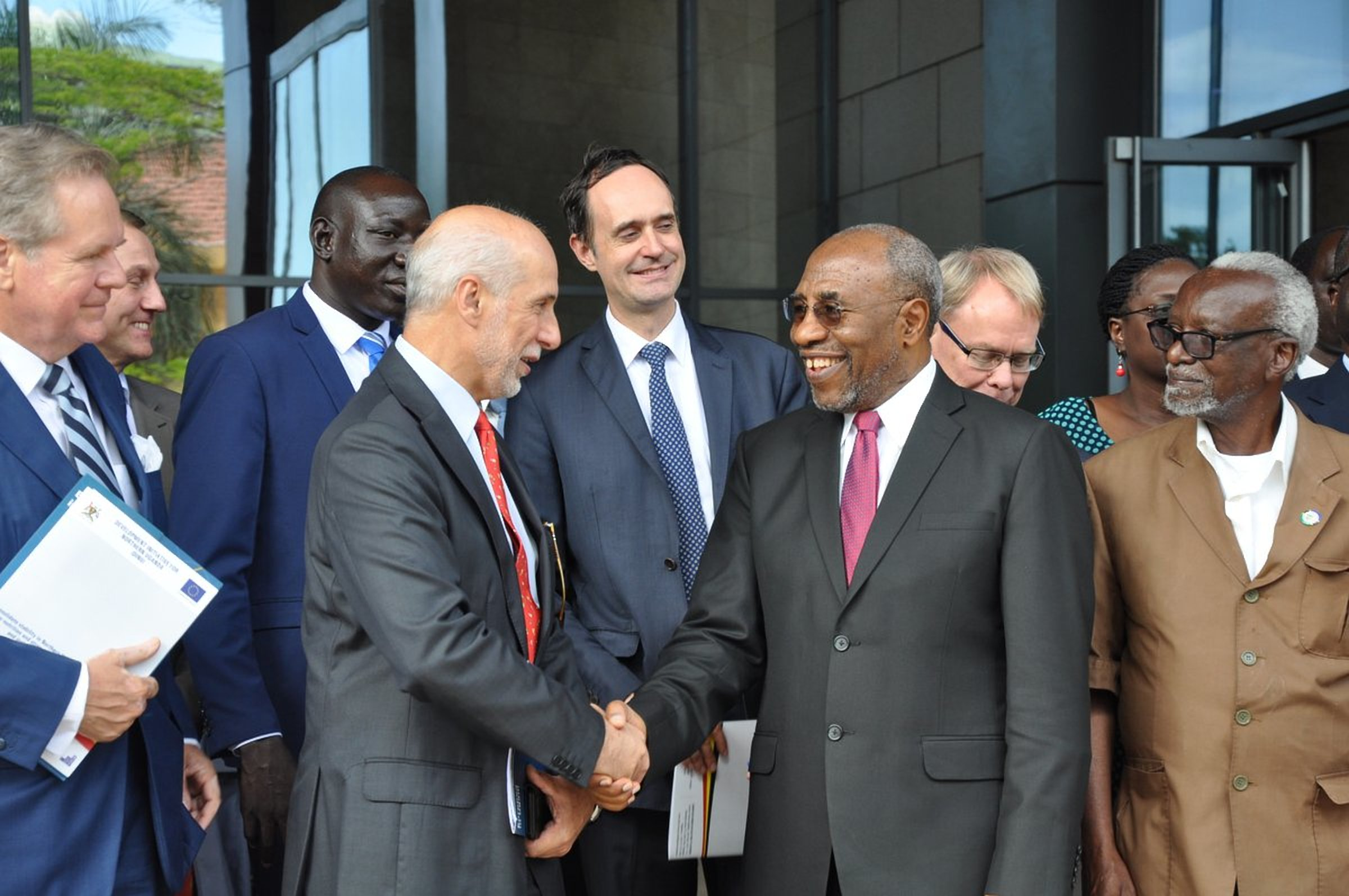 EU Ambassador to Uganda Mr Attilio Pacifici shares a light moment with Prime Minister, Hon. Ruhakana Rugunda at the DINU launch (COURTESY PHOTO)