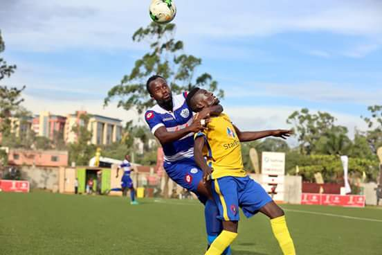 Proline's Savio Kabugo (left) fights for the ball with Derrick Nsibambi of KCCA on Tuesday
