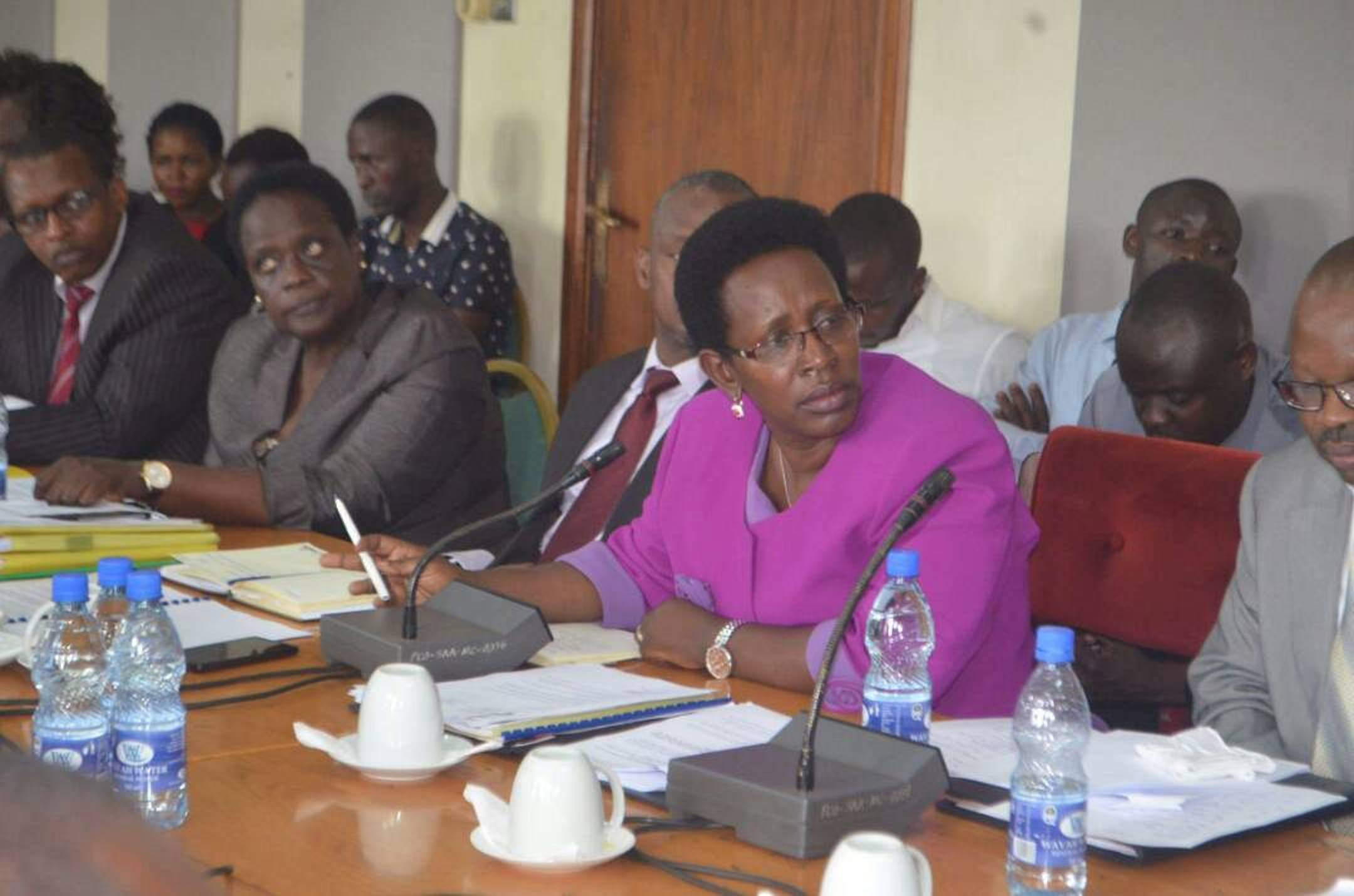 Dr Diana Atwine (in purple), the Permanent Secretary in the Ministry of Health appearing before the Committee of Parliament (COURTESY PHOTO)