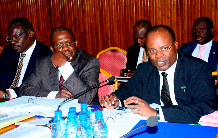 Bank of Uganda Depiuty Governor, Louis Kasekende,and other Bank officals appear before COSASE. (FILE PHOTO)