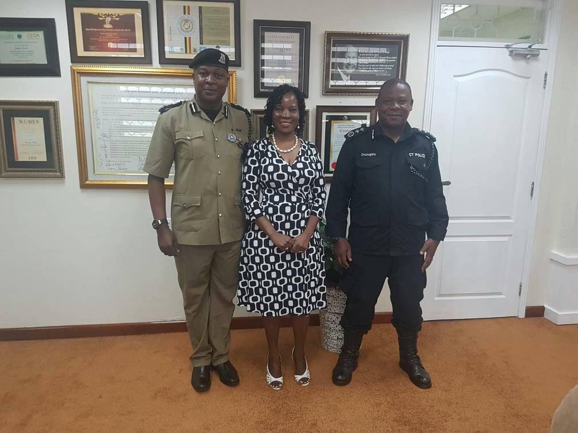 Kampala Metropolitan Police (KMP) Commander, Moses Kafeero Kabugo, and KCCA Executive Director Jennifer Musisi share a photo following Monday's meeting to discuss strategic security matters of Kampala (PML PHOTO)