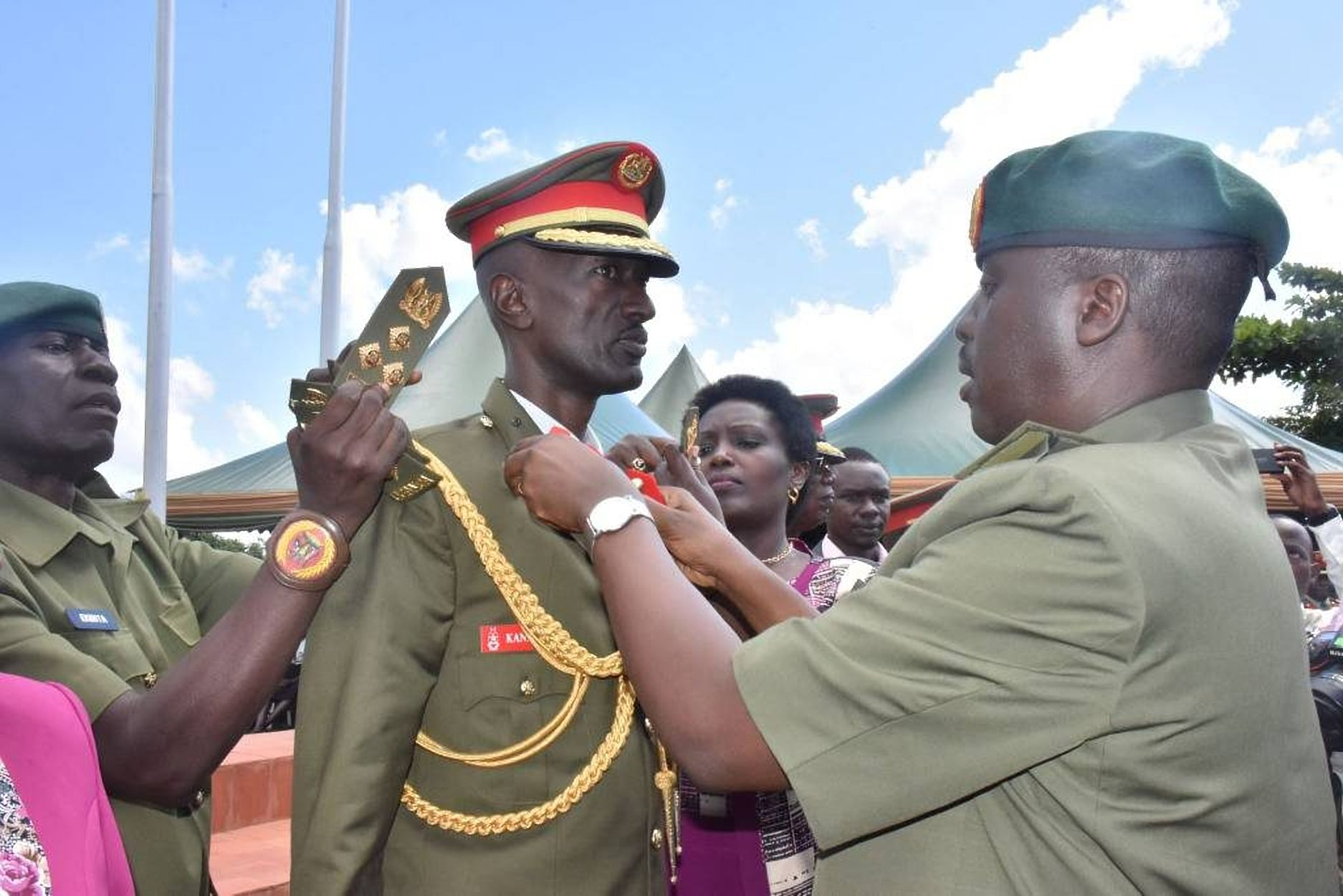 CDF Gen Muhoozi (R) decorates CMI Chief Col Abel Kandiho. He vanished for his dear life as protestors sorrounded him August 31(FILE  PHOTO)