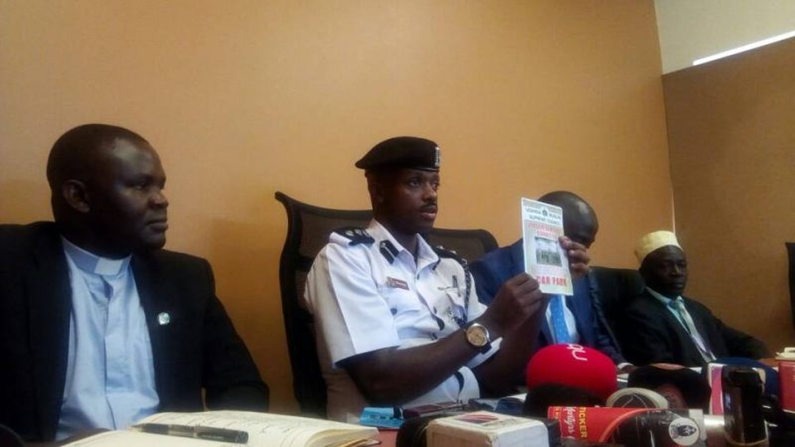 KMP traffic police commander SSP Norman Musinga displays stickers to be used on martyrs day as traffic guideline take on (COURTESY PHOTO)