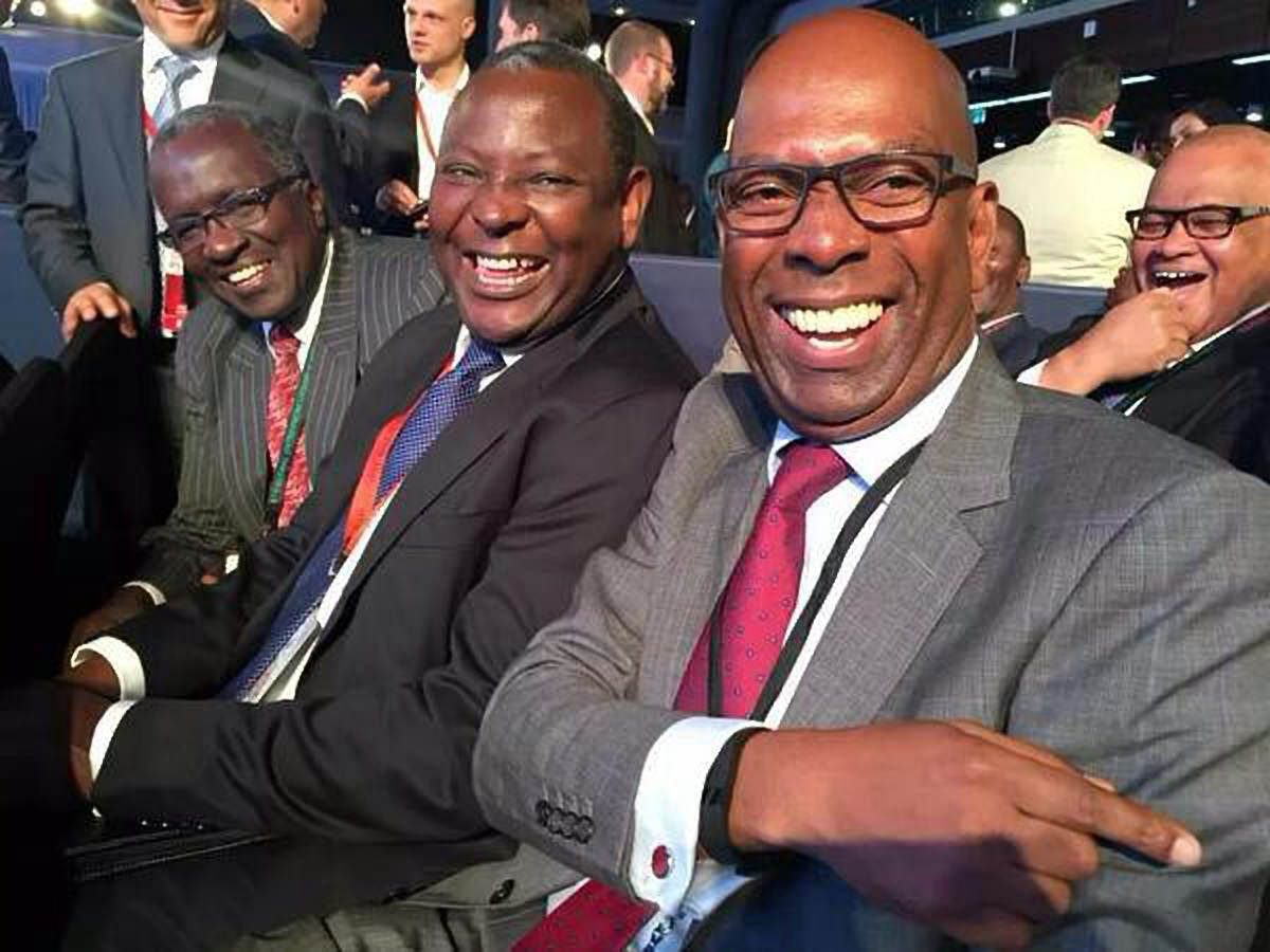 Safaricom CEO Bob Collymore (Right) and Equity Bank CEO Dr James Mwangi (Centre) at an event recently. Dr. James Mwangi was crowned the African Banker of the Year (COURTESY PHOTO)