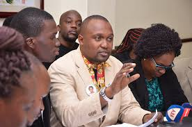 Uganda Medical Workers Association chairman Dr Ekwaro Obuku with other medics at a meeting recently.