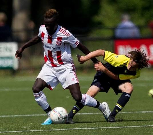 Moses Opondo (left) in action for Aalborg a few seasons ago.