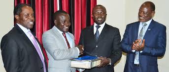 MUASA chairman Muhwezi with his predecessor