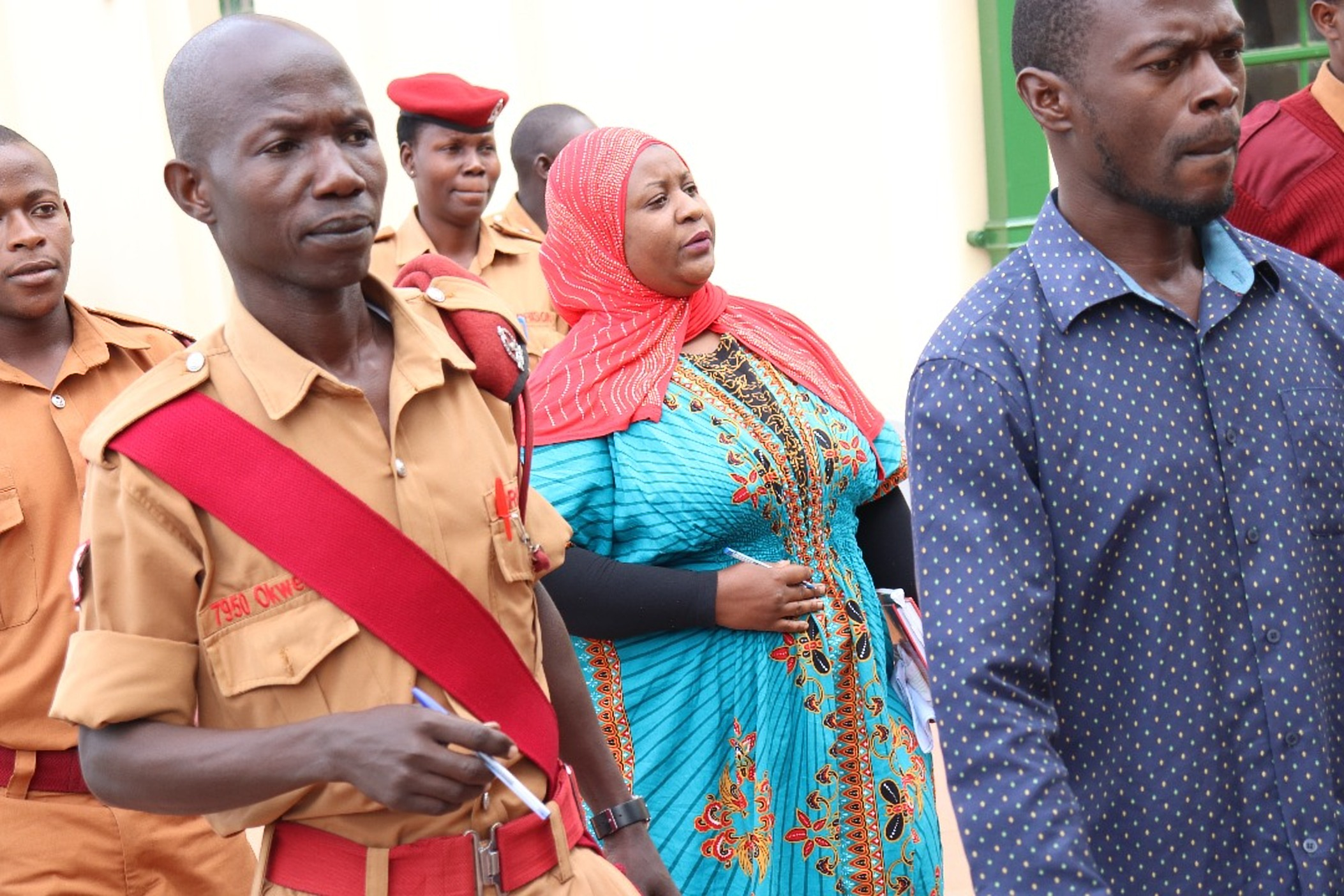Aisha Nakasibante, a sister in-law to cardiologist Dr. Aggrey Kiyingi escorted by Prisons Officers (COURTESY PHOTO)