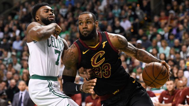 LeBron James (right) dribbles past Boston's Jaylen Brown (left) in game seven of the Eastern Conference finals