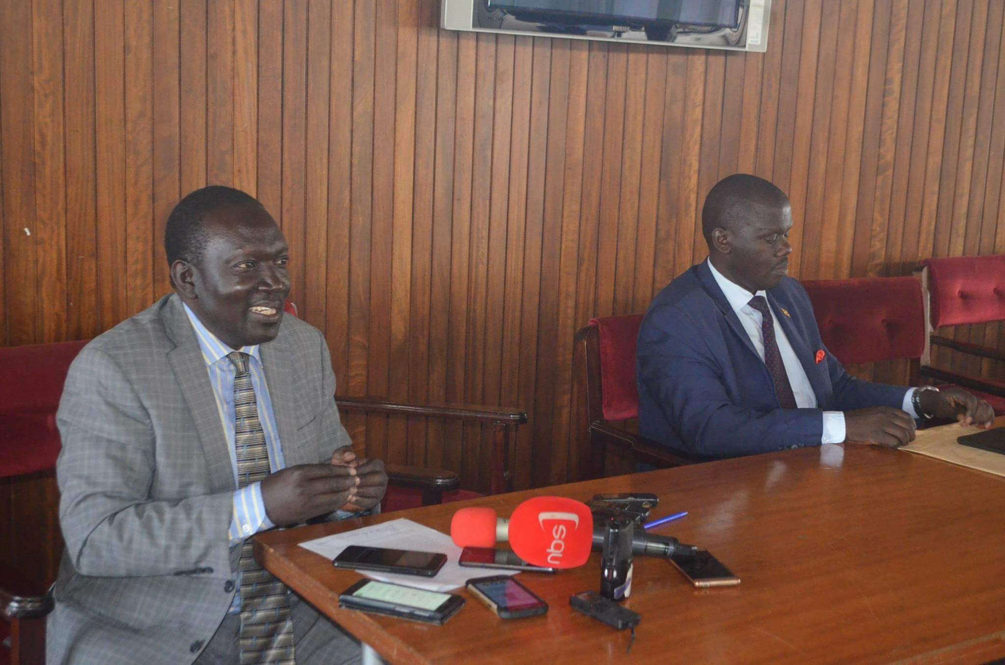 MPs Wmabede and Mugume address journalists in the Members'  Lounge at Parliament on Wednesday.