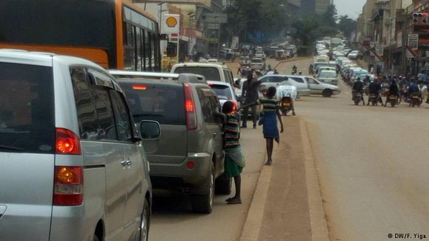 Street children beg motorists on jinja road, Kampala. Minster Nakiwala Kiyinji worries that it has been commercialised (FILE PHOTO)