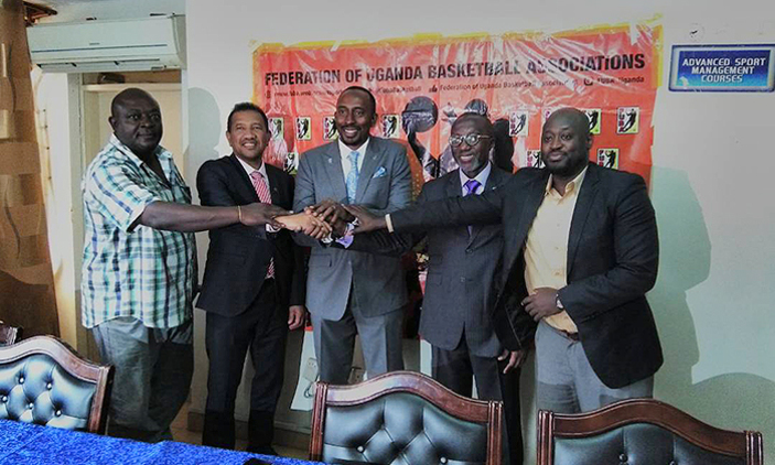 Jean-Michel Ramaroson (second left) poses alongside FUBA President Ambrose Tashobya (third right) Le'mou Benga, the FIBA National Federations and Sports Manager (second right) and  Brian Rugyendo (first right) at UOC offices on Friday (Photo by Agencies)