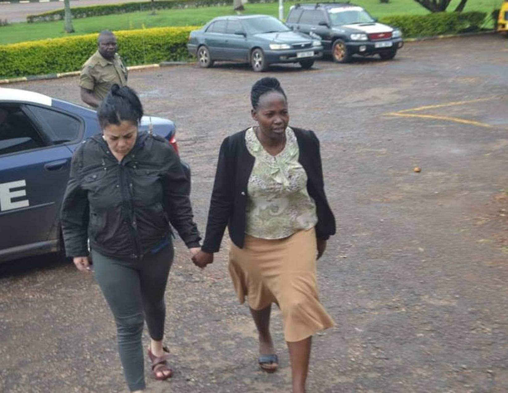 Venezuelan nationaL, 24, arrested by the Aviation Police at Entebbe being escorted to a protected facility