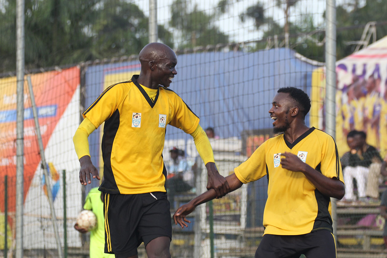 Bugisu's James Alitho (left) celebrates with Muwada Mawejje (right) at the StarTimes stadium on Sunday (Photos by FUFA media)