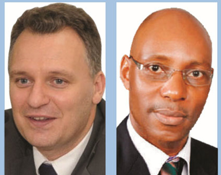 Deported MTN Uganda's CEO Wim Vanhelleputte and UCC ED Godfrey Mutabazi (FILE PHOTO)