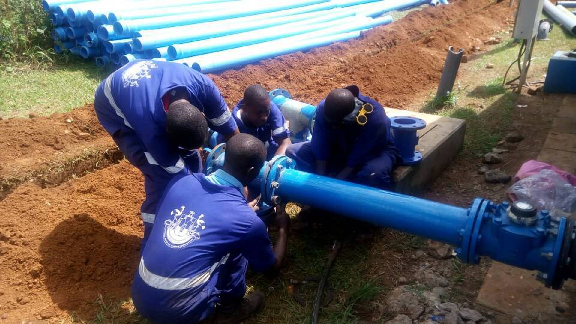 NWSC plumbing technicians set up water pipes. (PHOTO/File)
