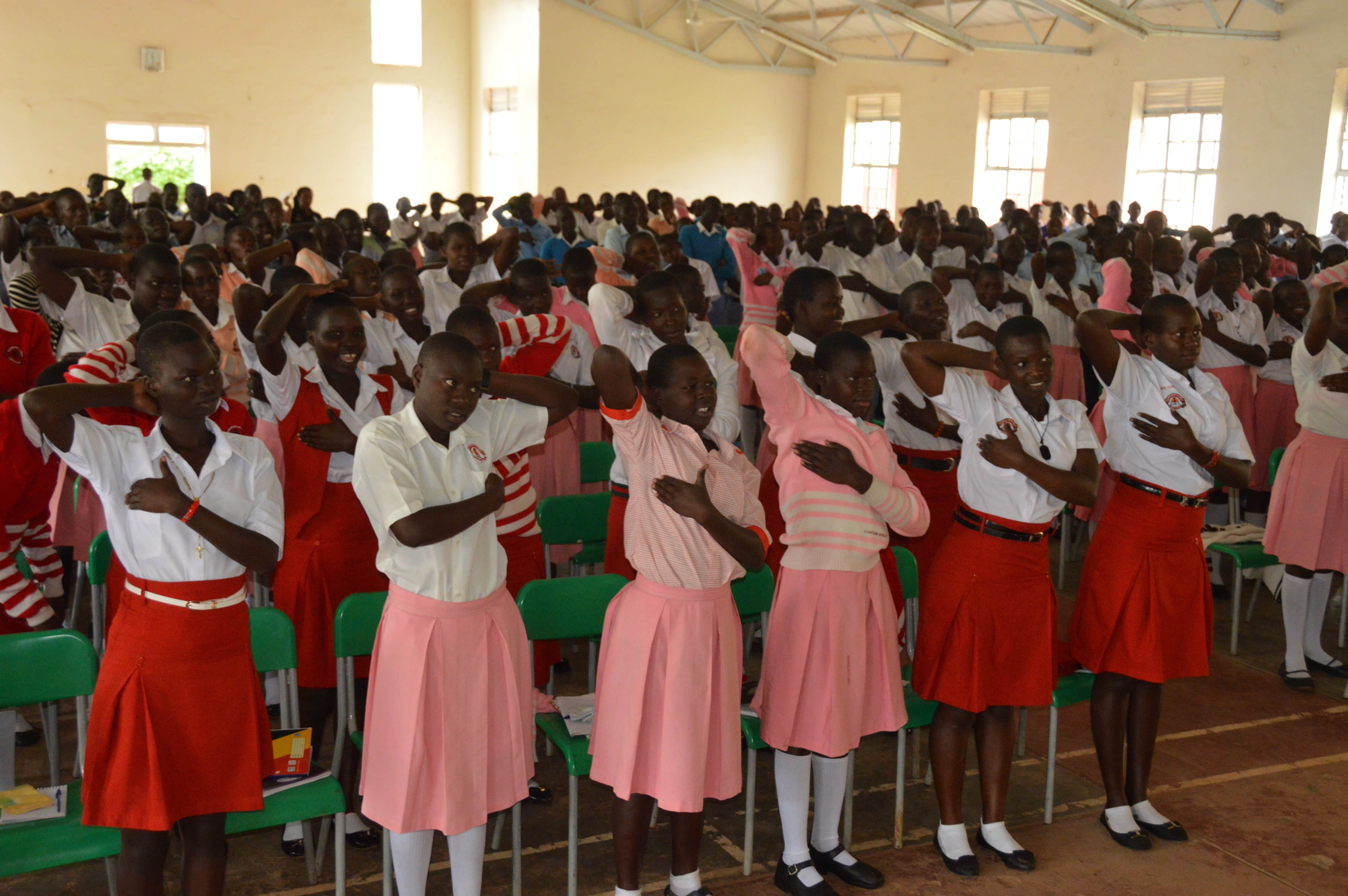 Students of sacred Heart school being taken through breast cancer check. PHOTO BY CISSY MAKUMBI