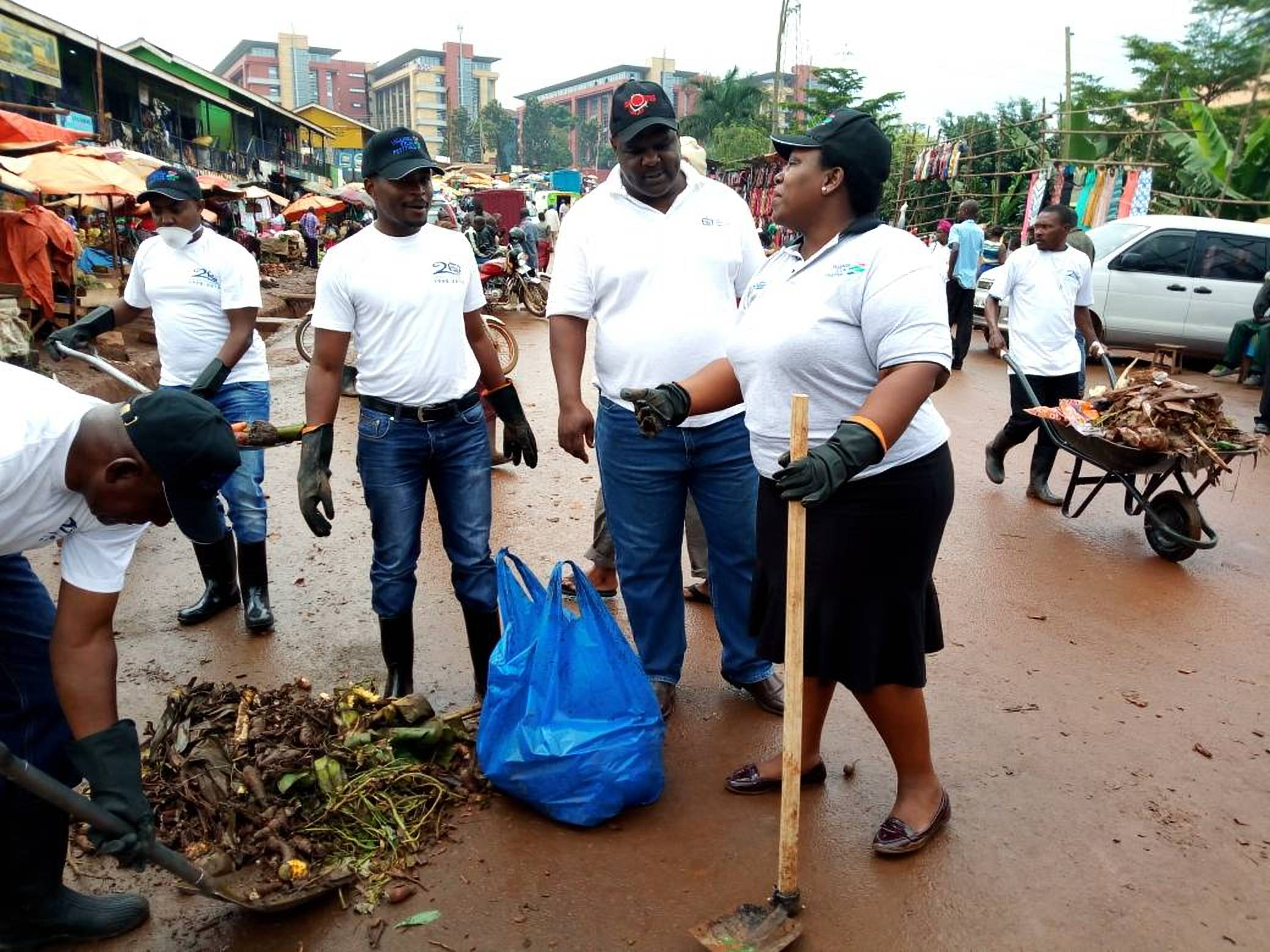UCC's head of public and International relations, Ms Pamela Ankunda shares an insight with colleagues as they rallied residents in the sanitation drive (Photo: SJavira)