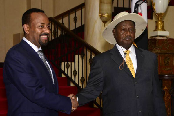 Ethiopia's PM shakes welcomed by President Museveni.