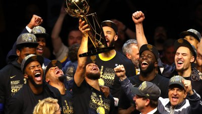 Stephen Curry holds high the NBA title after game 4 win in Ohio