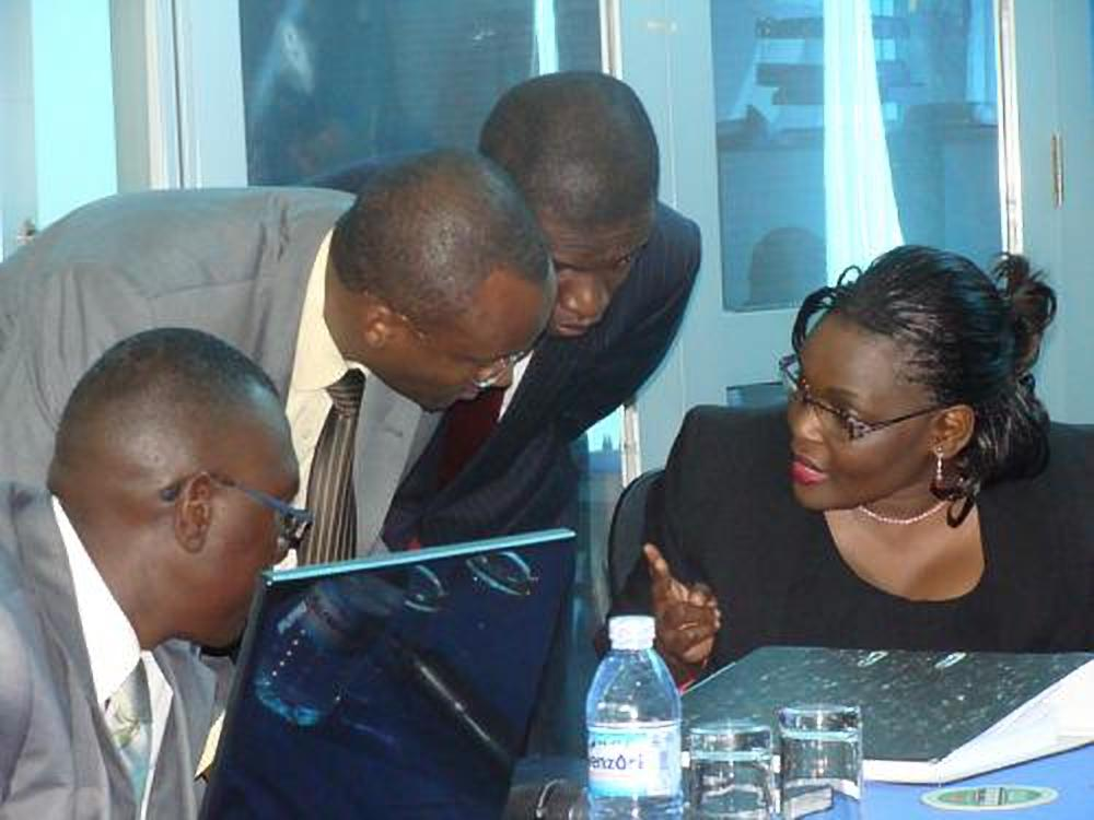 Lady Justice Catherine Bamugemereire (R) consults with members of the tribunal at one of the processions of the land probe commission. The tribunal has run to govt for help. (FILE PHOTO)