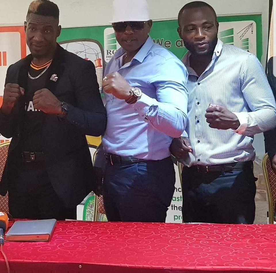 Golola Moses (left) mand Semata (right) pose for a photo at Mt Zion hotel on Tuesday