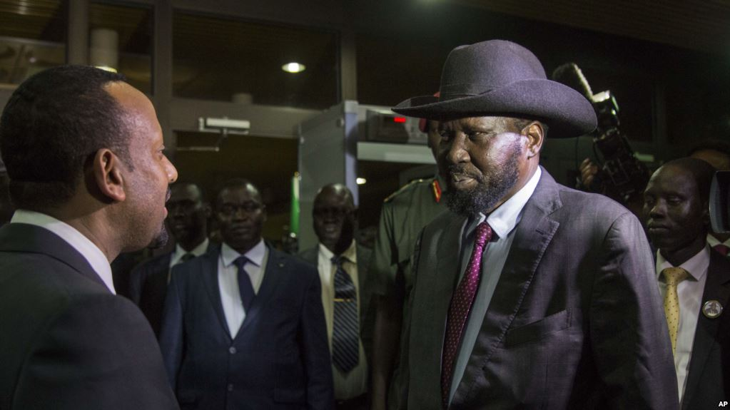South Sudan's President Salva Kiir, right, is greeted by Ethiopia's Prime Minister Abiy Ahmed, left, as Kiir arrives for a meeting with South Sudan's opposition leader Riek Machar, in Addis Ababa, Ethiopia, yesterday.