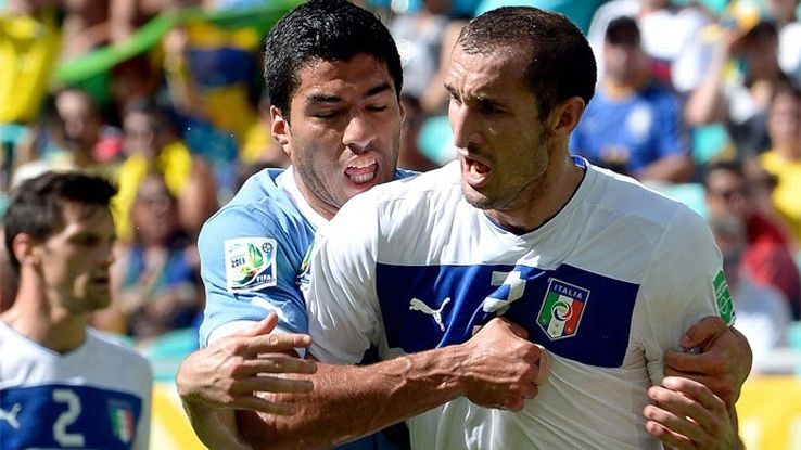 Uruguay's Luis Suarez (left) bit Ghioghio Chellini (right) at the 2014 World Cup