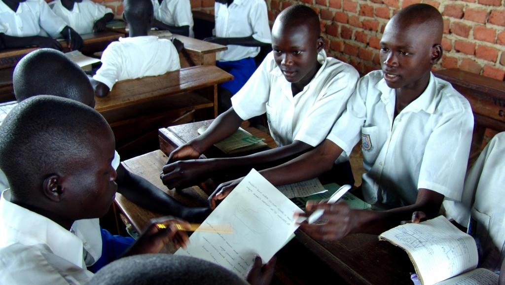 Ugandan primary school students studying in their classroom .Teaching of Chinese language has become common in many schools across the country.